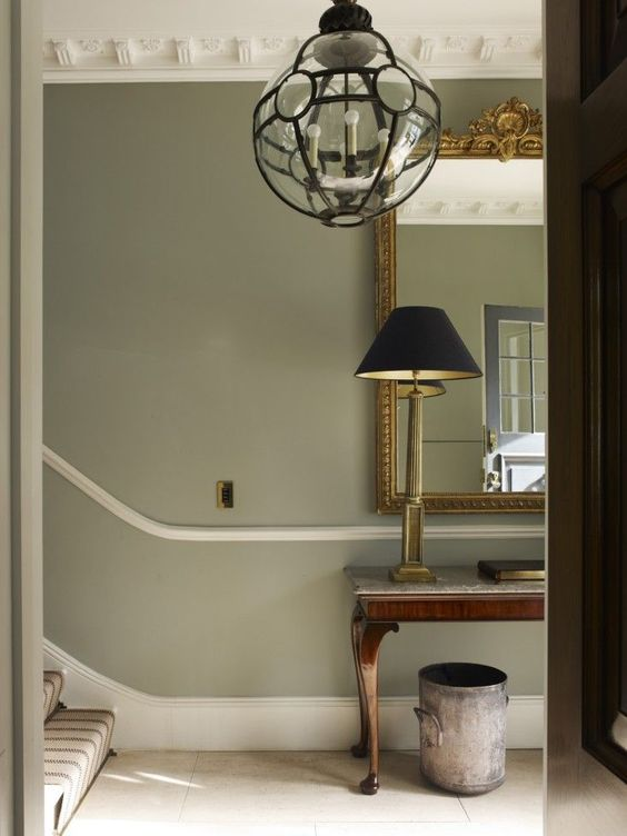 Ball Green by Farrow & Ball in an elegant entry with soft green grey walls and beautiful trim and moldings.  Come learn about the 12 Best Calm Paint Colors {Top Picks from Designers!} #paintcolors #farrowandball #ballgreen