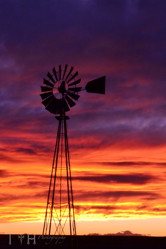 Amazing sunset behind this windmill