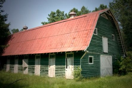 The iconic Dallas V. Carnes barn standing in its original location at the intersection of Highway 176 and 17-A.