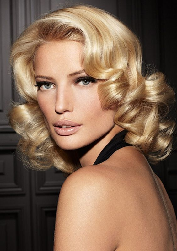 If you have curly medium length hair than classic curls are always a good choice.