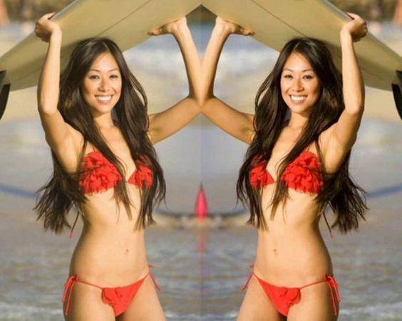 Beautiful beach babes. Surfing, sunbathing, in bikinis.