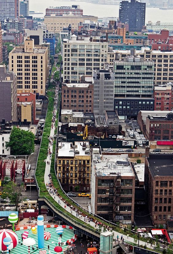 Walk The High Line, in New York City - an elevated park in the sky built on top of the tracks of a disused railway, weaves its way through the city blocks.