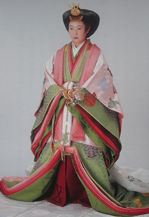 A woman dressed in junihitoe (Japanese ceremonial kimono which could weigh 40 pounds).