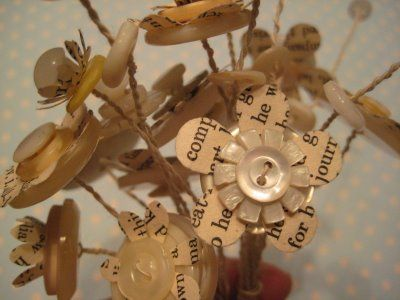 Book & Button Flower Bouquets.  Save your used little glass bottles to put them in (think vanilla bottles or old salt and pepper shakers) Wrap some raffia around the top.  I've made them w/out the book pages also.  Very cute little gifts.