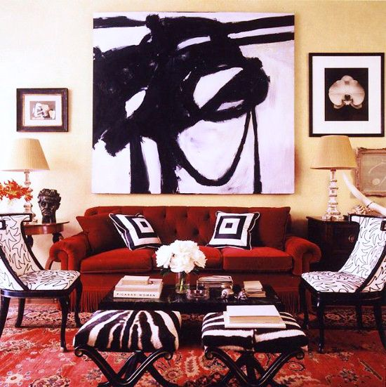 Why you need black and white abstract art // Black and white abstract painting over red sofa // living room