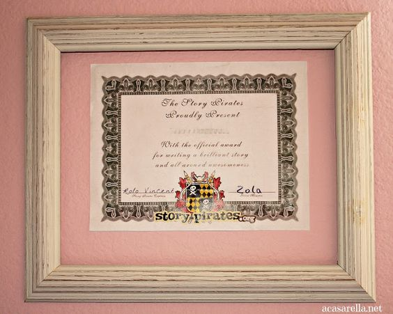 Hang empty frames in which you can display kids' certificates of achievement.  Just swap one out when the next one comes in!