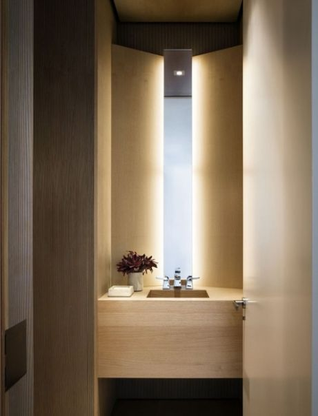 slim mirror with back lighting - bathroom or great cloak room idea (powder room):
