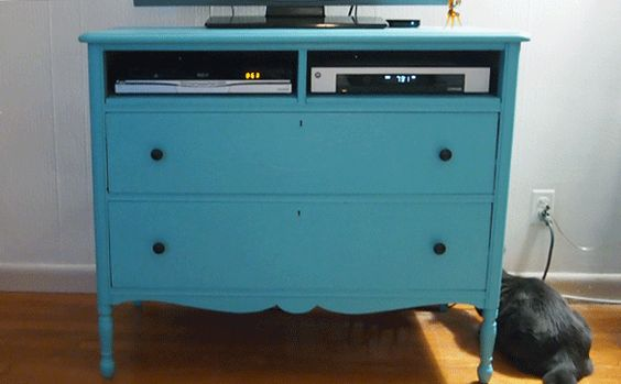 We turned an old dresser into our entertainment center. #DIY #paint #IKEA #craigslist