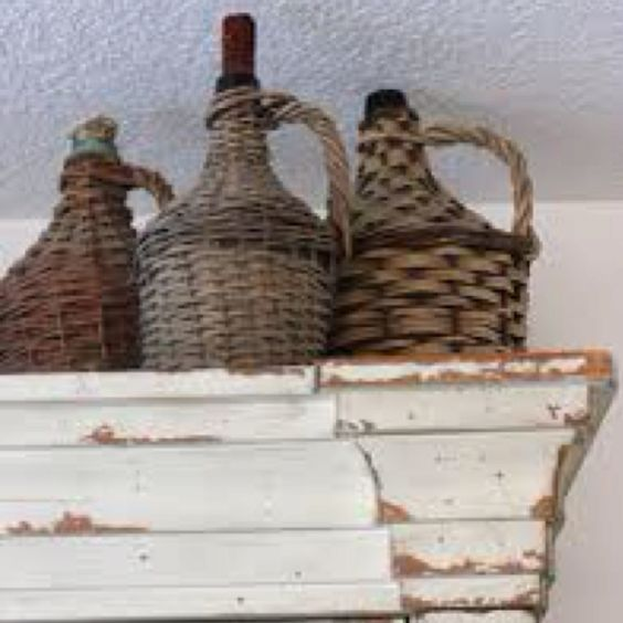 Vintage wine bottles. Love. They make great light fixtures if you're creative with electricity!