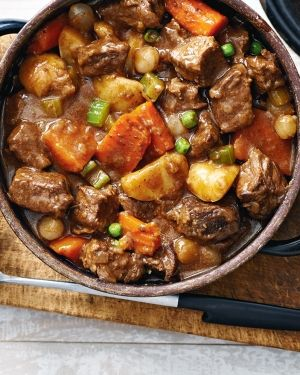 Our ultimate beef stew becomes even more delicious when made with well-marbled pot roast rather than the usual stewing beef. The fat melts slowly as it cooks, tenderizing the beef into juicy melt-in-your-mouth morsels. Photo by Jeff Coulson.