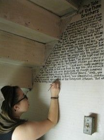 A whole chapter of the seventh Harry Potter book painted on the wall. Not Harry Potter, but cool for something!