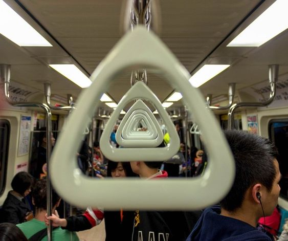 3. Perfectly aligned handles in Taipei Metro -  Happy Worthy Life. Creativity - Wonder - Inspriration - Art