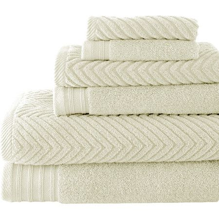 Add a resort-worthy touch to your guest suite or master bath with these combed cotton towels, showcasing a herringbone weave in ivory.