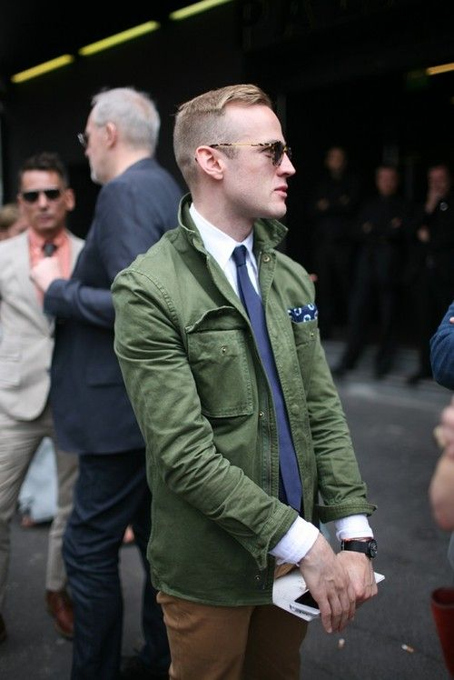 Shop this look for $222: http://lookastic.com/men/looks/military-jacket-and-dress-shirt-and-pocket-square-and-tie-and-chinos/1108 — Green Military Jacket — White Dress Shirt — Navy Print Pocket Square — Navy Tie — Tobacco Chinos: