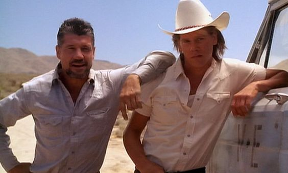 (Kevin Bacon)) as Valentine McKee and  (Fred Ward) as Earl Bassett in the movie Tremors.