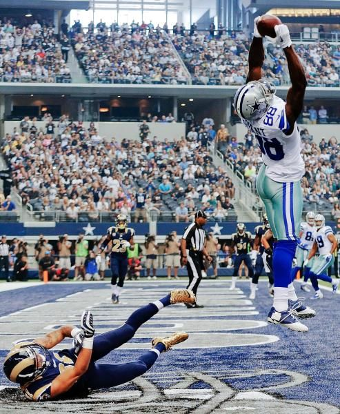 Dallas Cowboys wide receiver Dez Bryant (88) makes a touchdown reception as St. Louis Rams' Cortland Finnegan