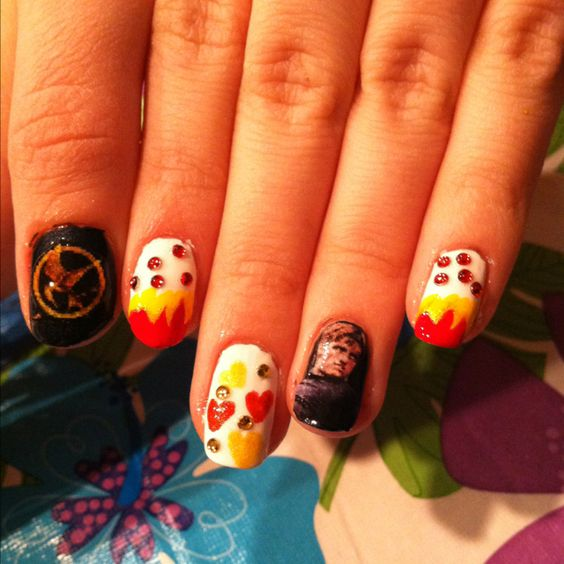 Nails I did for my sister for the premiere of the hunger games!!!!!!