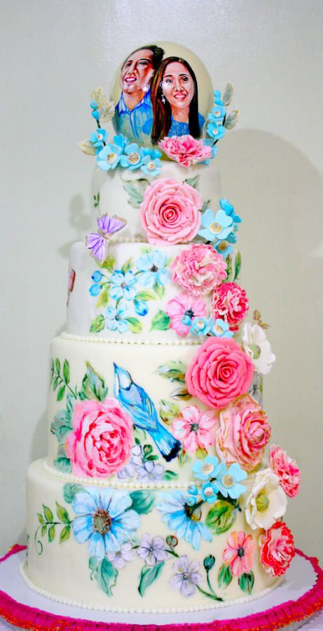 Of Birds and Flowers - Cake by Mucchio di Bella. A hand painted cake with handmade gum paste flowers. Beautiful for a spring wedding.