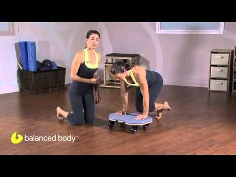 Lizbeth Garcia shows how to use the Orbit to do the classic Pilates exercise Knees Off, but without the reformer.