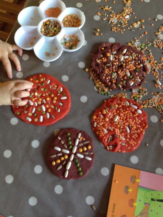Patterns on playdough using natural grains - Butterflies Childminding ≈≈