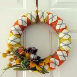 With Fall being just around the corner, why not  cozy up your door with an argyle yarn wreath?