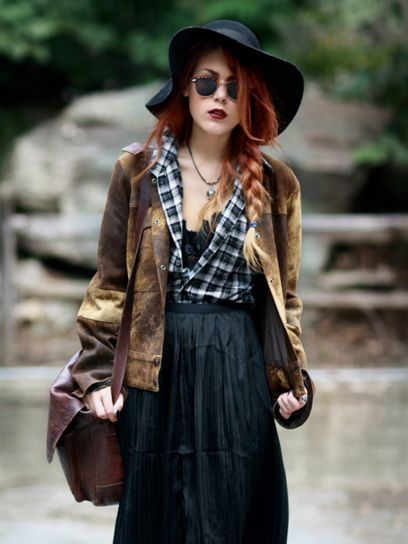 A wide brimmed hat, long skirt and beaten uo jacket call for a tough look that transforms plaid from outdoors to edgy.
