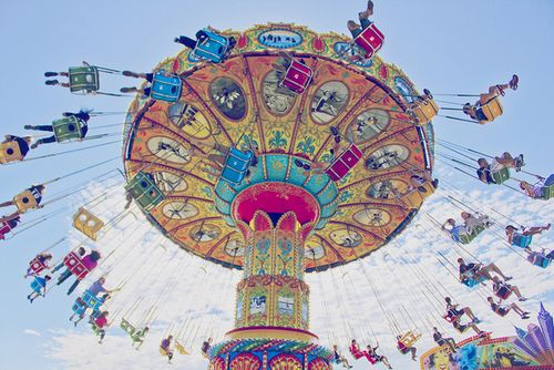 coolest fair ride ever! I love how the photographer captures the movement of the  swings.