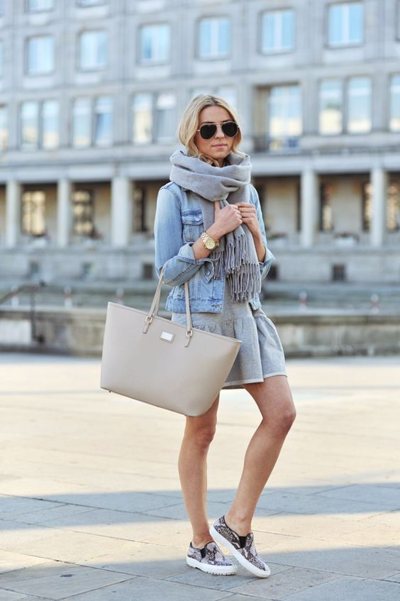 Katarzyna Tusk is wearing a grey dress from Sugarfree, snake print slip-ons from Zara, denim jacket from Mango, bag from Kappahl and the sca...