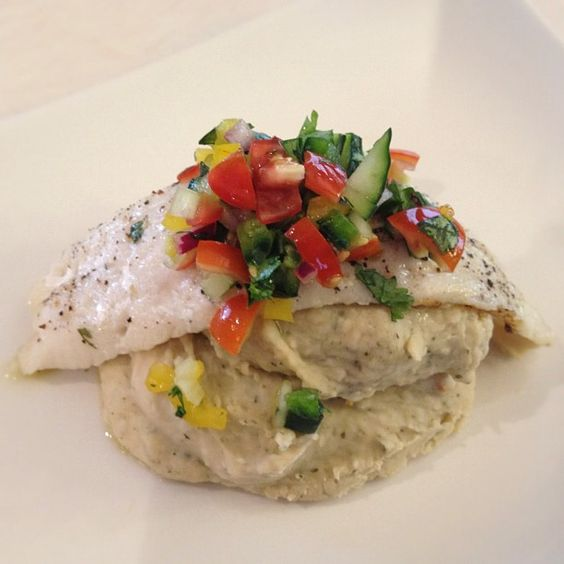 Baked Cod with Cucumber Salsa over Whipped Northern Beans: Great Northern Beans are cooked with minced garlic, organic butter & fresh cilantro then put them in the food processor with a little bit of milk, salt & pepper. Season cod with cracked salt/pepper, lemon juice.... Salsa is lime juice, cilantro, grape tomatoes, cucumbers, red onion, poblano pepper and red & yellow pepper