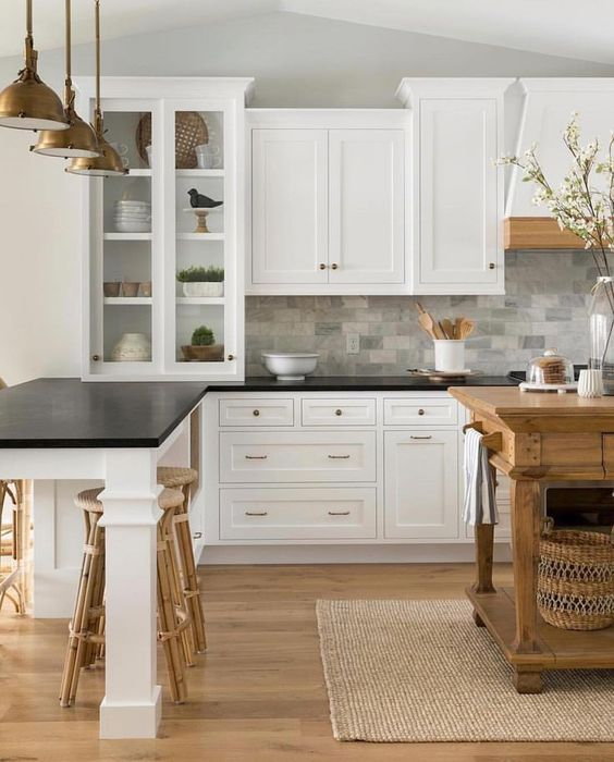Vintage Inspired White Cabinets With Black Countertops And A Grey Marble Tile Backsplash For A Black Kitchen Countertops New Kitchen Cabinets Black Countertops