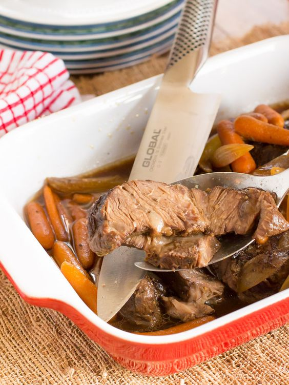 Dig into this hearty Crock Pot Beef Roast with a sweet and tangy sauce. It's quick to throw together and perfect to come home to after a long day!
