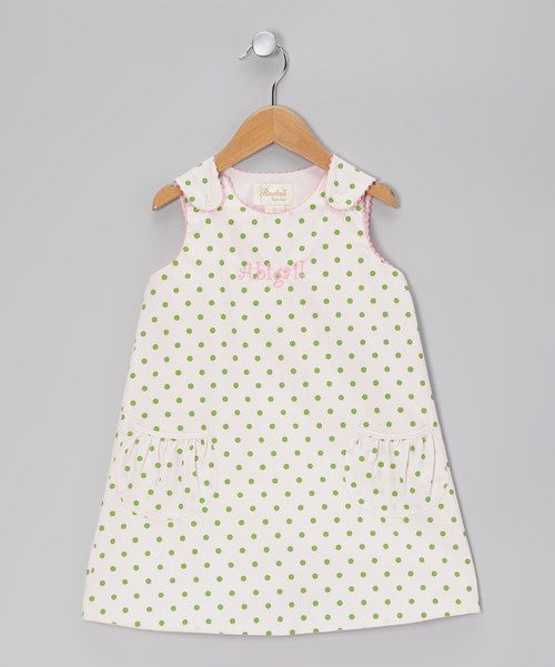 Nothing gets us excited for sunshine like a sweetly dotted sundress! Buttons down the back and custom embroidery create an heirloom quality that will always transcend the trends. Buttoned straps and pockets add an extra dose of charm. Personalize up to eight characters65% polyester / 35% cottonMachine wash