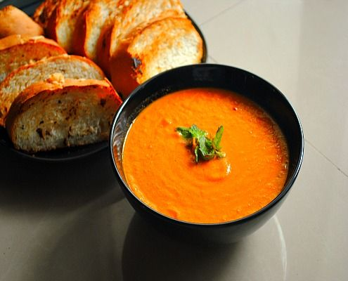 A delicious broth based flavorful tomato soup with basil
