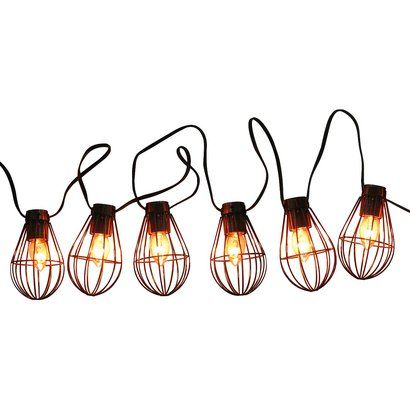 Cute, cute, cute! Smith and Hawken caged bulb outdoor patio string lights and they are a super ...