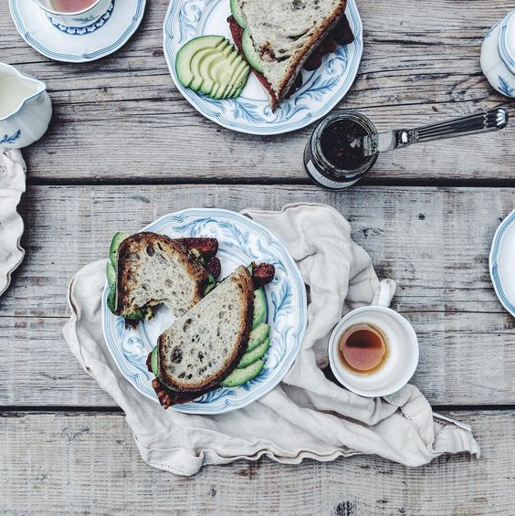 It is grey and heavy outside apparently about to pour and we are gulping bacon and avocado sandwiches with chilli jam. by jo_rodgers