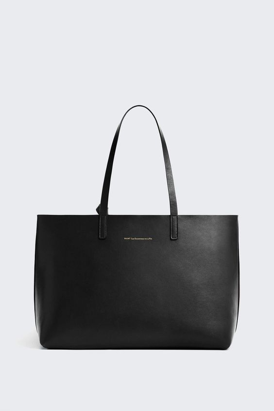 Want Les Essentiels de la vie Strauss tote made from 100% leather is completely reversible to a muted metallic finish. Featuring a removable interior zippered c