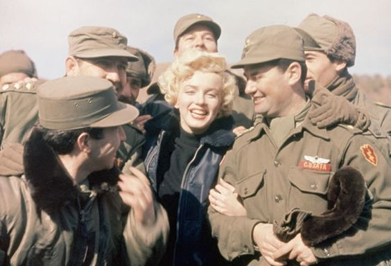 Marilyn Monroe Entertaining Troops: American movie actress Marilyn Monroe entertains a group of soldiers in Korea. (Photo Credit: Bettmann/CORBIS)