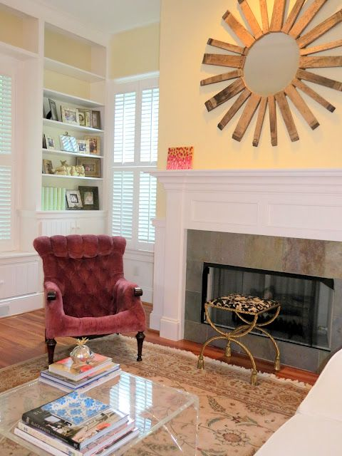lucite coffee table, oak barrel mirror, deep pink tufted chair