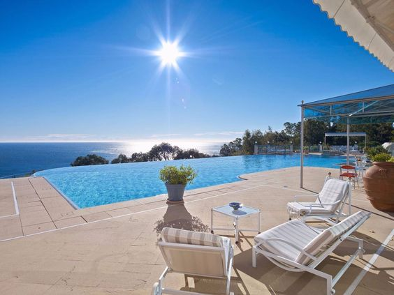 Luxury real estate in Cannes FR - Villa Belvoir - contemporay property boasting panoramic sea views - JamesEdition