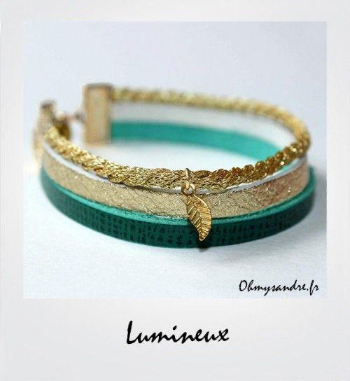 Bracelet manchette composé de liens en cuir or et vert émeraude, d'une cordelette doré et d'une petite feuille dorée Taille : 15 à 18 cm Largeur : 1,5 cm 10 euros Commander