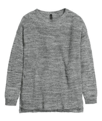 Long, rib-knit jumper in a cotton blend with dropped shoulders, long sleeves, a slit at one side of the hem and zip at the other. Slightly longer at the back.