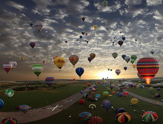 The largest hot-air balloon gathering in the world, Chambley, France.  Two wishes in one....go to France, take hot air balloon ride!