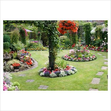 Colorful Back Garden With Borders Filled With Tender
