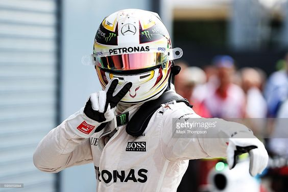 Lewis Hamilton of Great Britain and Mercedes GP celebrates getting pole position in parc ferme during qualifying for the Formula One Grand Prix of Italy at Autodromo di Monza on September 3, 2016 in Monza, Italy.