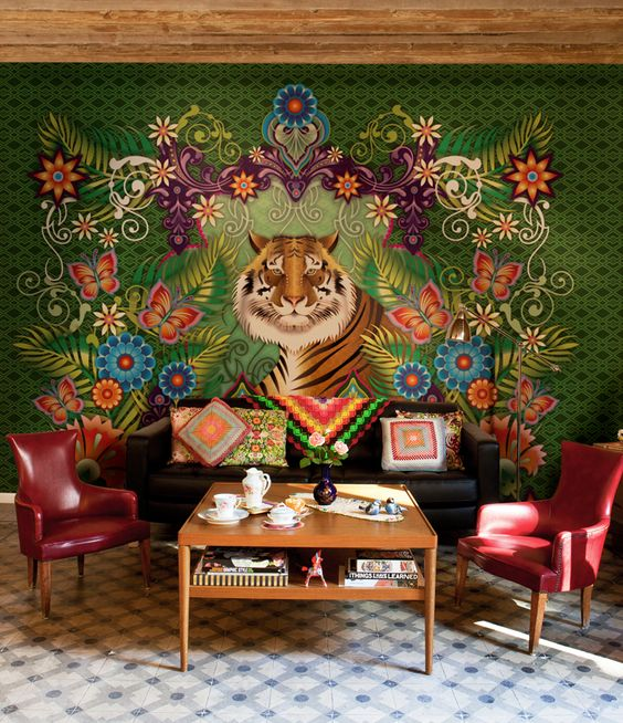 Designer: Catalina Estrada, Barcelona, Spain With a combined passion for nature and color, this wall mural is a feast for the eyes. The interwoven patterns of flowers, leaves, and butterflies create a surrounding frame for a serene, large tiger.