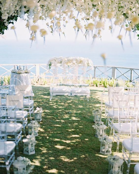 """""""We're drooling over this floral-filled #Bali #wedding! This #ceremony is for the most romantic of couples! Stay tuned for one of the #bride's 3 stunning…"""""""