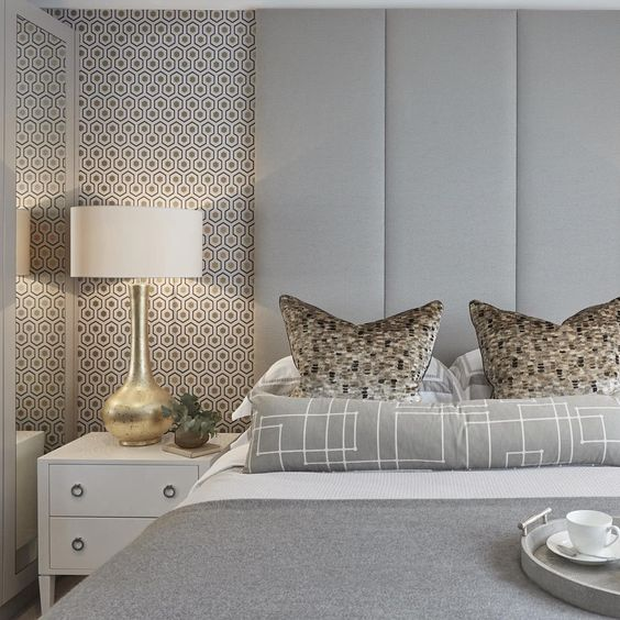 Guest bedroom at the Esher project in grey and gold
