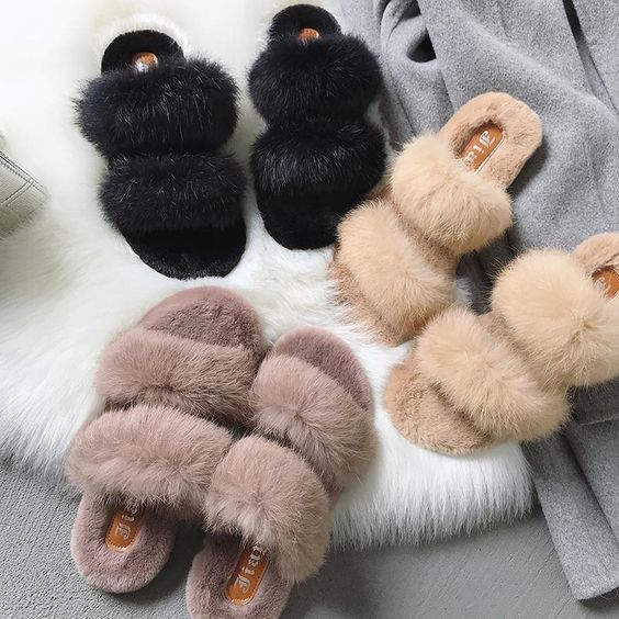Fluffy Plush adult slippers. Soft and fluffy to the touch, made with amazing quality! These Slippers are great to wear around the house and even to run little errands in comfort. Get yours today and your feet will thank you later!