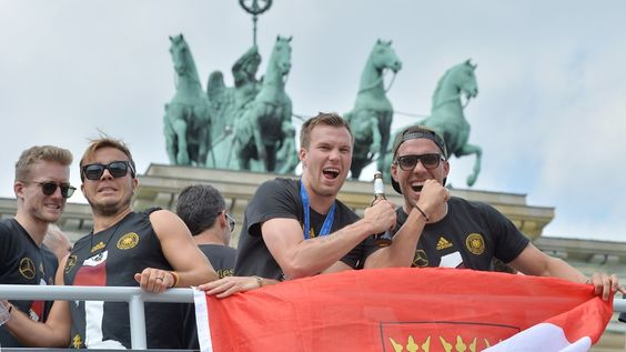 Fifa World Cup 2014 Brazil: GERMAN Celebration: World Champions welcoming in Berlin (official Fifa/afp images): bus trophy (2405971) • Germany wins 4th cup (1954+74+90+14)!! Equal to Italy. Only needing to beat one more, Brazil's 5. Germany's Mario Götze made only but beautiful goal in match against Argentina at 113th min in 2nd 1/2 of extra time, avoiding penalties!