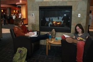 Students stay warm and cozy by the fire in the Dining Hall at Skidmore College — a great place to catch up on readings for class.